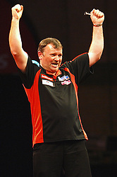 England's Terry Jenkins celebrates after beating Co Stompe of the Netherlands 4-1 to move to the next round in the Darts World Championships at Alexandra Palace, London, Tuesday, Dec.. 27, 2011. Photo by Morn/I-Images