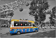 Day Tripper - London South Bank is a selective colour street photography series by photographer Paul Williams  of tourists and an ice cream van by the London Eye South Bank London taken in 2008 . .<br /> <br /> Visit our REPORTAGE & STREET PEOPLE PHOTO ART PRINT COLLECTIONS for more wall art photos to browse https://funkystock.photoshelter.com/gallery-collection/People-Photo-art-Prints-by-Photographer-Paul-Williams/C0000g1LA1LacMD8