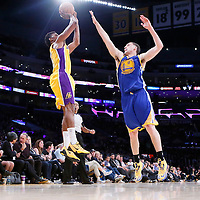 11 April 2014: Los Angeles Lakers forward Nick Young (0) takes a jumpshot over Golden State Warriors guard Klay Thompson (11) during the Golden State Warriors 112-95 victory over the Los Angeles Lakers at the Staples Center, Los Angeles, California, USA.