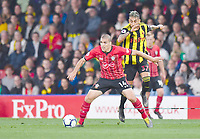 FOOTBALL - 2018 / 2019 Premier League - Watford vs Southampton<br /> <br /> Southampton's Oriol Romeu holds off the challenge from Watford's Roberto Pereyra, at Vicarage Road.<br /> <br /> COLORSPORT/ASHLEY WESTERN