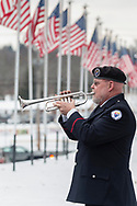 Goshen, New York - A bugler plays during a Wreaths Across America ceremony at Orange County Veterans Memorial Cemetery on Dec. 16, 2017. About 3,000 wreaths were placed at graves, and small American flags were added to the wreaths at veterans' graves.