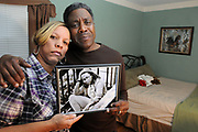 (Mara Lavitt — New Haven Register) <br /> December 12, 2013 West Haven<br /> Celeste and Gregory Fulcher, parents of Key Club shooting victim Erika Robinson, in her bedroom at their home in West Haven.