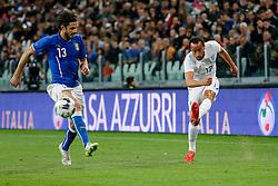 Andros Townsend of England crosses past Andrea Ranocchia of Italy - Photo mandatory by-line: Rogan Thomson/JMP - 07966 386802 - 31/03/2015 - SPORT - FOOTBALL - Turin, Italy - Juventus Stadium - Italy v England - FIFA International Friendly Match.