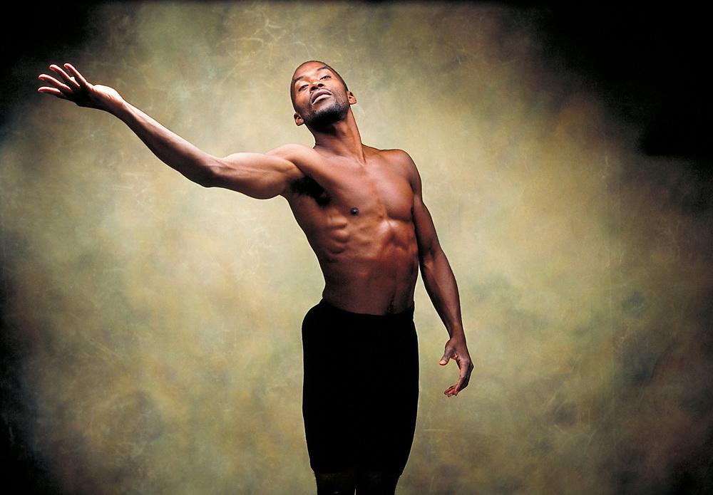 A male dancer in studio.