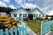 Pretty cottages opposite The local church in The village of Dungegan, Ballinskelligs, County Kerry, Ireland.<br /> Picture by Don MacMonagle