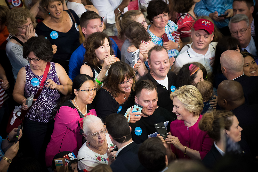 Former Secretary of State Hillary Clinton, the Democratic Nominee for President of the United States, takes selfies with reporters after a rally at McGonigle Hall at Temple University in Philadelphia, Pennsylvania on July 29, 2016.<br /> <br /> Credit: Cameron Pollack / The Cornell Daily Sun