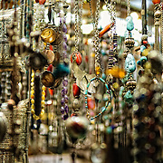 Jewelry hangs on display for sale in one of the many tiny stores of Istanbul's historic Grand Bazaar, Shallow depth of field.