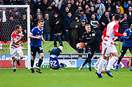 Daniel Iversen of Oldham Athletic (1) collects the ball after some unorthodox defending by Peter Clarke of Oldham Athletic (26) during the The FA Cup fourth round match between Doncaster Rovers and Oldham Athletic at the Keepmoat Stadium, Doncaster, England on 26 January 2019.