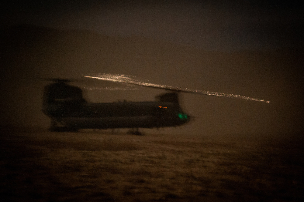 Sparks fly from the rotors of a U.S. Army Chinook helicopter as it extracts U.S. Marines and Afghan National Army soldiers from the Depak Valley.