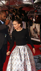 Israeli US actress Natalie Portman tries a few dance steps with an aide holding an umbrella in the pouring rain as she arrives for the World Premiere of her latest film Thor The Dark World.  in London's Leicester Square, England, United Kingdom. Tuesday, 22nd October 2013. Picture by Max Nash / i-Images