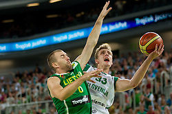 Tomas Delininkaitis of Lithuania vs Zoran Dragic of Slovenia during friendly match before Eurobasket Lithuania 2011 between National teams of Slovenia and Lithuania, on August 24, 2011, in Arena Stozice, Ljubljana, Slovenia. (Photo by Vid Ponikvar / Sportida)