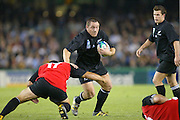 17 October 2003, Rugby Union World Cup, Pool game, All Blacks vs Canada, Telstra Dome, Melbourne, Australia.<br />All Black, Mark Hammett pushes off a defender.<br />Pic: Sandra Teddy/Photosport