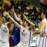 Anadolu Efes's Kerem Gonlum (L) and Birkan Batuk (C) during their Turkish Basketball League match Anadolu Efes between Antalya BSB at the Ayhan Sahenk Erdem Arena in Istanbul, Turkey, Sunday, February 24, 2013. Photo by Aykut AKICI/TURKPIX