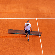 PARIS, FRANCE October 11.  A ground staff member prepares the clay court surface for the Singles Final on Court Philippe-Chatrier during the French Open Tennis Tournament at Roland Garros on October 11th 2020 in Paris, France. (Photo by Tim Clayton/Corbis via Getty Images)