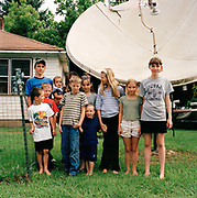 Photographed in the neighbourhood of Robbinsville  these children are all looked after by their grandmother over the summer holidays: with a little help from a satellite dish and  125 channels of television.