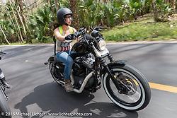 Deneille Basualdo riding through Tomoka State Park during Daytona Bike Week 75th Anniversary event. FL, USA. Thursday March 3, 2016.  Photography ©2016 Michael Lichter.