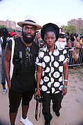August 22, 2015- Brooklyn, NY-United States:  (L-R) Artist Derrick Adams and Photographer Zanele Muholi attend the 2015 AFROPUNK Festival on August 22, 2015 held at Commodore Barry Park in Brooklyn, New York City.  AFROPUNK is an influential community of young, gifted people of all backgrounds who speak through music, art, film, comedy, fashion and more. Originating with the 2003 documentary that highlighted a Black presence in the American punk scene, it is a platform for the alternative and experimental.(Terrence Jennings/terrencejennings.com)
