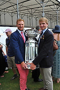 Henley. Great Britain. 175th  Henley Royal Regatta, Henley Reach. England. Will SATCH (left) and Constantine LOULOUDIS, holding the trophy, the Grand Challenge Cup, with the new base, after being part of the winning crew, Leander Club and University of London. 17:11:03  Sunday  06/07/2014. [Mandatory Credit; Peter Spurrier/Intersport-images]