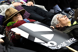 "May 3, 2019 - London, Greater London, United Kingdom - Activist seen performing a ""die-in"" during the protest..Anti-nuclear activists gathered opposite Westminster Abbey in London to protest against a service of thanksgiving organised by The Royal Navy to mark 50 years of Britain's submarine-based nuclear weapons. Anti-nuclear activists performed a ""die-in"" outside Westminster Abbey representing the victims of nuclear war. (Credit Image: © Andres Pantoja/SOPA Images via ZUMA Wire)"