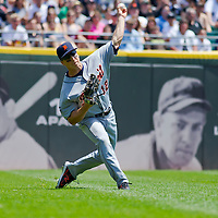 Chicago, IL - June 05, 2011:  Detroit Tigers left fielder, Andy Dirks (12) throws a ball back into the infield against the Detroit Tigers at U.S. Cellular Field on June 5, 2011 in Chicago, IL.