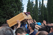 The body of a minor killed in Soma is brought to the site of mass burial on the outskirts of the city. An electrical fault caused an explosion in the shaft resulting in at least 282 workers being killed in the disaster. Soma, Western Turkey.