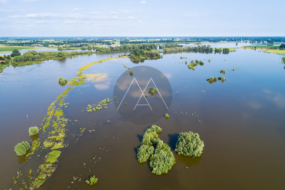 Aerial view of flooded floodplains along river IJssel during high water in summer, Welsumer Waarden, Gelderland and Overijssel, The Netherlands.