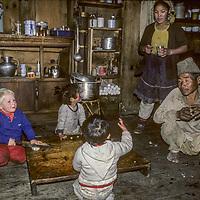 NEPAL, HIMALAYA Trekking youngster visits Sherpa innkeeper & children, Namche Bazar.