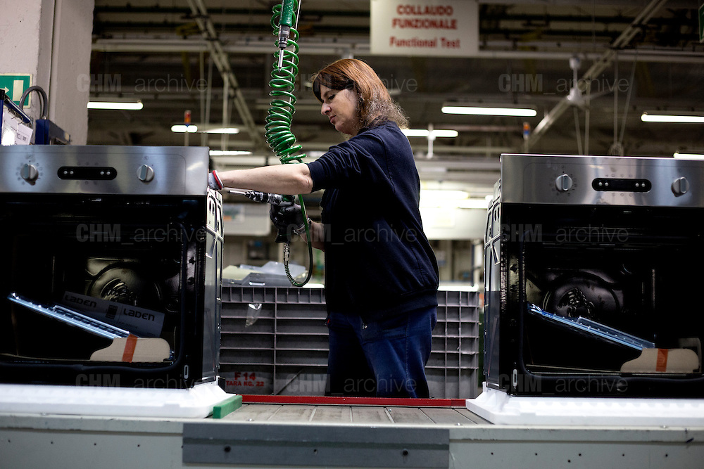 A woman working in the factory of Whirlpool Corporations. Cassinetta di Biandronno, Varese, Milan, Italy, 30 january 2014. Guido Montani / OneShot