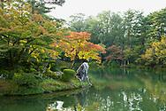 Autumn foliage on Horajima Island in Kasumi Pond in the Kenrokuen Garden, Kanazawa, Ishigawa, Japan