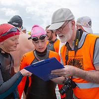 Event Organisor Liam O'Meara taking names before the charity swim