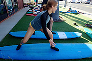 Mimmi Widstrand, on a surf board, Maui, Hawaii.