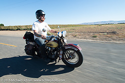 After his HD VL suffered a catastrophic failure, Jason Sims rides a 1939 Harley-Davidson Knucklehead from Carl's Cycles during Stage 15 (244 miles) of the Motorcycle Cannonball Cross-Country Endurance Run, which on this day ran from Lewiston, Idaho to Yakima, WA, USA. Saturday, September 20, 2014.  Photography ©2014 Michael Lichter.