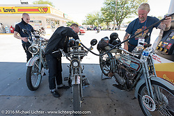 Thomas Trapp (R), owner of the Harley-Factory Frankfurt dealership in Germany stops to gas up his 1916 Harley-Davidson along with Paul Jung (center) with his 1915 Harley and son Eric (L) with his 1916 Harley at a stop on the eastern plains of Colorado during the Motorcycle Cannonball Race of the Century. Stage-9 Dodge City, KS to Pueblo, CO. USA. Monday September 19, 2016. Photography ©2016 Michael Lichter