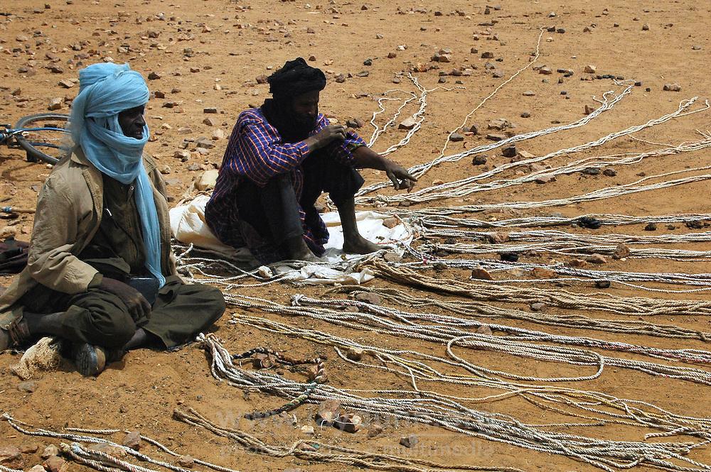 BURKINA FASO, Gorom-Gorom, 2007. Tuareg nomads sell halters and lead ropes for a variety of animals at Gorom-Gorom's Thursday animal market.