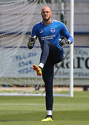 """Brighton and Hove Albion's Goalkeeper David Button warms up before kick off during a pre season friendly match at The Cherry Red Records Stadium, Kingston Upon Thames. PRESS ASSOCIATION Photo. Picture date: Saturday July 21, 2018. Photo credit should read: Mark Kerton/PA Wire. EDITORIAL USE ONLY No use with unauthorised audio, video, data, fixture lists, club/league logos or """"live"""" services. Online in-match use limited to 75 images, no video emulation. No use in betting, games or single club/league/player publications."""