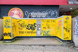 DHL self service parcel drop off lockers covered in graffiti in Berlin Germany