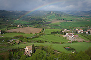 A rainbow hangs over the green landscape beneath Orvieto, Umbria, Italy.