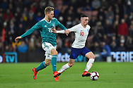 Phil Foden of England U21's battles for possession with Arne Maier of Germany U21's during the U21 International match between England and Germany at the Vitality Stadium, Bournemouth, England on 26 March 2019.