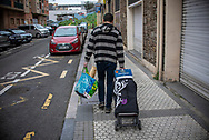 Berdaitz, a volunteer member of the Donostia Helping Network, delivers some food for Maria Angeles who who is confinated at home as she belongs to the risk group. Donostia (Basque Country). April3, 2020. (Gari Garaialde / Bostok Photo)