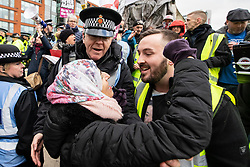 "© Licensed to London News Pictures . 09/02/2019. Manchester , UK . An anti fascist faces off with JAMES GODDARD (r) during a "" Yellow Vest "" protest in Manchester City Centre . The yellow vest concept has been adopted from French demonstrators by some British groups in support of Brexit , Donald Trump and former EDL leader Stephen Yaxley-Lennon - aka Tommy Robinson . A similar demonstration in the city in January was ridiculed after protesters were kettled by police in front of a branch of Greggs the Baker . Photo credit : Joel Goodman/LNP"