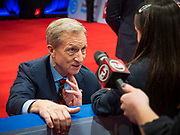 "14 JANUARY 2020 - DES MOINES, IOWA: California businessman TOM STEYER talks to a child in the ""spin room"" after the CNN Democratic Presidential Debate on the campus of Drake University in Des Moines. This is the last debate before the Iowa Caucuses on Feb. 3.    PHOTO BY JACK KURTZ"