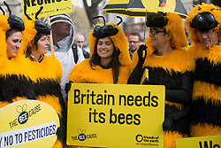 © Licensed to London News Pictures. 26/04/2013. London, UK. Protesters dressed as bees stage a demonstration in Parliament Square, London on April 26, 2013. Over 100 beekeepers  from across the UK march on Parliament in opposition to the Government's plan to oppose a ban on bee killing pesticides in a crucial EU vote on Monday. Photo credit : Peter Kollanyi/LNP