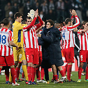 Atletico Madrid's players celebrate victory during their UEFA Europa League Round of 16, Second leg soccer match Besiktas between Atletico Madrid at Inonu stadium in Istanbul Turkey on Thursday March 15, 2012. Photo by TURKPIX