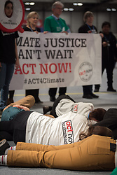 6 December 2019, Madrid, Spain: Faith-based actors led by ACT Alliance, the Lutheran World Federation, and the World Council of Churches 'sound the alarm for climate justice' at COP25, through a protest where a giant alarm clock went off, followed by testimonies of people already affected by climate change, and the chant, 'What do we want? Climate justice! When do we want it? Now! Where do we want it? Everywhere!'