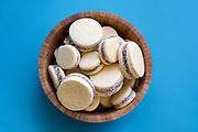 A bowl of freshly baked Alfajor cookies