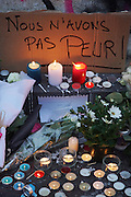"""""""We are not afraid"""". Place Republique, Parisians pay hommage to those killed and wounded in the Terrorist attacks<br /><br />The Day after the terrorist jihadi attacks. Bullet holes and blood, mourning homage and cleaning up. Aftermath of deadly Paris terrorist attacks. Saturday 14th November 2015<br /> <br /> Eight terrorists dead and some 128 people killed at Stade de France, Bataclan concert Hall, Belle Equipe Restaiurant, Rue Fontaine au Roi, Two hundred people have been injured, 80 of them seriously."""