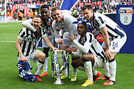 Millwall players pose with the trophy after the game. EFL Skybet football league one play off final match, Bradford city v Millwall at Wembley Stadium in London on Saturday 20th May 2017.<br /> pic by Steffan Bowen,  Andrew Orchard sports photography.