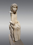 """Ancient Egyptian statue of Iteti, sandstone, Old Kingdom, 5th Dynasty, (2500-2400 BC), Mastaba. Egyptian Museum, Turin. Grey background.<br /> <br /> Fragmentary sandstone statue inscribed for Iteti, identified as """"inspector of wab-priests of the pyramid of Khufu""""; Iteti, wearing curly wig and moustache (engraved on face), seated on chair with bull's legs. .<br /> <br /> If you prefer to buy from our ALAMY PHOTO LIBRARY  Collection visit : https://www.alamy.com/portfolio/paul-williams-funkystock/ancient-egyptian-art-artefacts.html  . Type -   Turin   - into the LOWER SEARCH WITHIN GALLERY box. Refine search by adding background colour, subject etc<br /> <br /> Visit our ANCIENT WORLD PHOTO COLLECTIONS for more photos to download or buy as wall art prints https://funkystock.photoshelter.com/gallery-collection/Ancient-World-Art-Antiquities-Historic-Sites-Pictures-Images-of/C00006u26yqSkDOM"""
