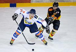 Miha Ahacic of Triglav vs Igor Angelovski of Slavija  at SLOHOKEJ league ice hockey match between HK Slavija and HK Triglav Kranj, on February 3, 2010 in Arena Zalog, Ljubljana, Slovenia. Triglaw won 4:1. (Photo by Vid Ponikvar / Sportida)