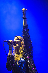 © Licensed to London News Pictures. 13/12/2013. London, UK.   Crystal Fighters performing live at The O2 Arena, supporting headliner Two Door Cinema Club. In this pic - Eleanor Fletcher.  Crystal Fighters are a British alternative dance band composed of members Sebastian Pringle, Gilbert Vierich, Graham Dickson, Eleanor Fletcher.    Photo credit : Richard Isaac/LNP